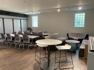 Our collaboration space can transform from meeting space to social hour at the end of your event!