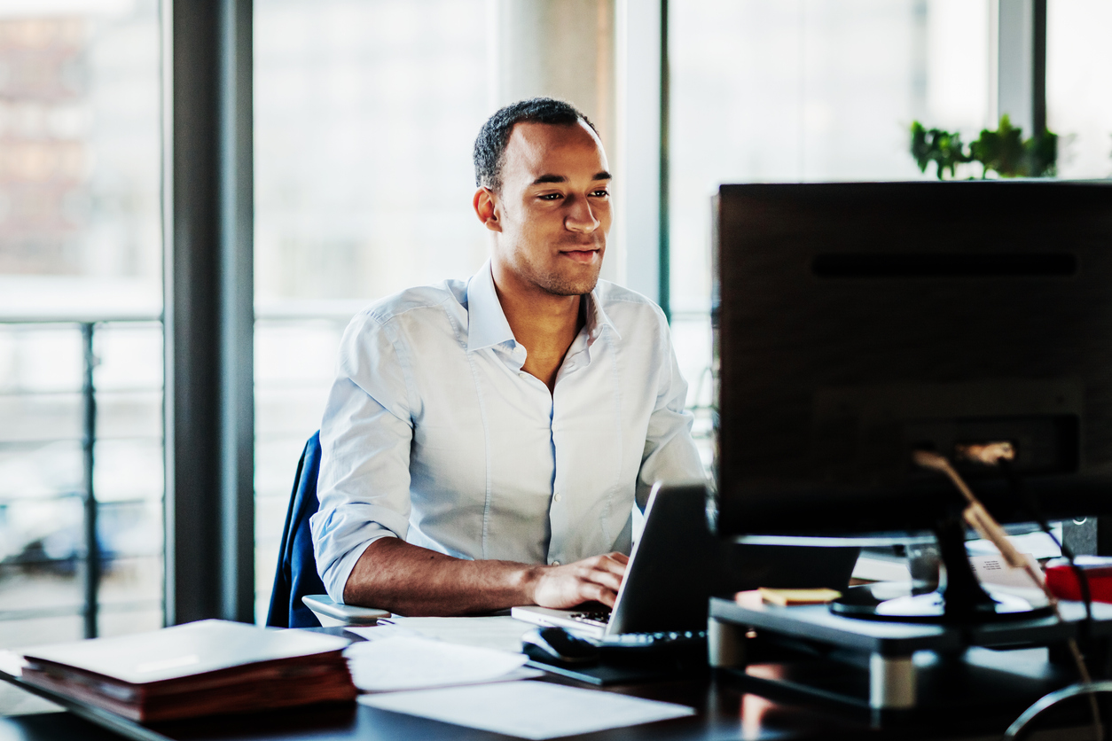 man working on ad copy on computer