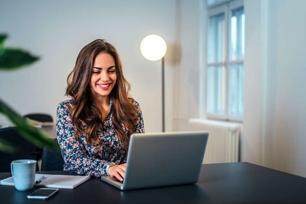 woman working on content promotion on laptop